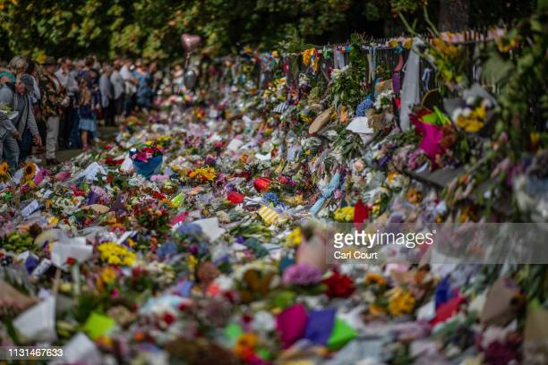 People view flowers and tributes by the botanical gardens on March 19 2019 in Christchurch New Zealand 50 people were killed and dozens are still...
