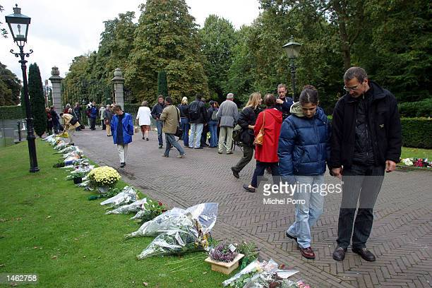 People view flowers left outside the royal Palace Huis ten Bosch October 7 2002 in The Hague The Netherlands Prince Claus husband to Queen Beatrix...