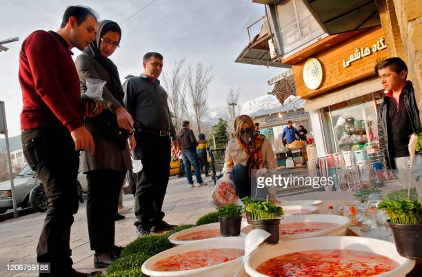 People view items for sale ahead of Nowruz the Persian New Year outside the Tajrish Bazaar in Iran's capital Tehran on March 12 2020 Iran said on...