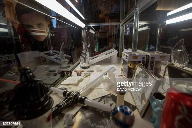 People view memorabilia during a public memorial for Carrie Fisher and her mother Debbie Reynolds on March 25 2017 in Los Angeles California Friends...