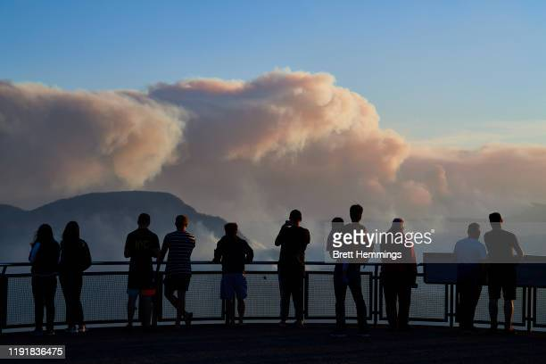 People view smoke from scattered bush fires on a look out platform in the Blue Mountains on December 04, 2019 in Katoomba, Australia. It is estimated...