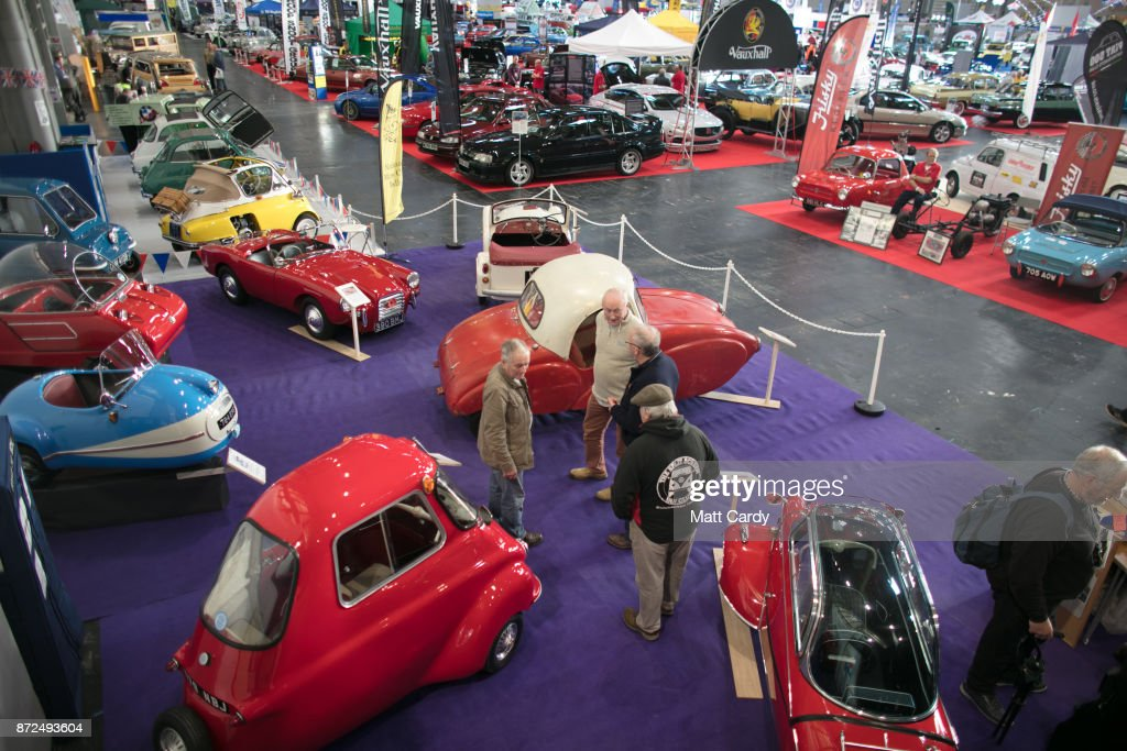 People view some of the classic cars that are being displayed on the first day of the Lancaster Classic Motor Show at the NEC Birmingham on November 10, 2017 in Birmingham, England. According to a recent survey by the Federation of British Historic Vehicles Clubs, the historic vehicle industry currently generates revenues in excess of £5.5 billion per year for the UK economy, and while current government policy is to promote self-driving and low carbon cars, according to Transport Minister Chris Grayling his party is also committed to supporting owners of classic cars, and those that want to continue to use them on the road in the future.