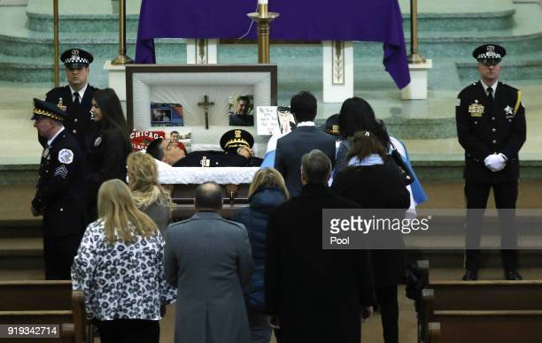People view the body of slain Chicago police Cmdr Paul Bauer at Nativity of Our Lord Roman Catholic Church on February 17 2018 in Chicago Illinois...