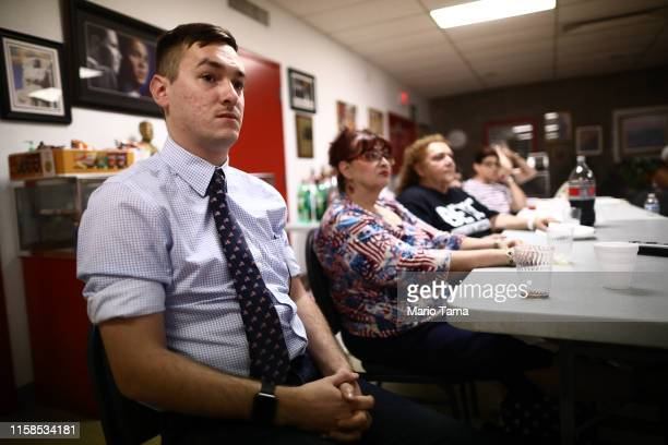 People view the debate broadcast during a watch party hosted by the El Paso Democrats for the first night of the Democratic presidential debate on...