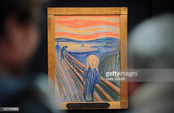 People view the Norwegian artist Edvard Munch's 1895 pastel on board work entitled 'The Scream' at Sotheby's auction house in central London on April...