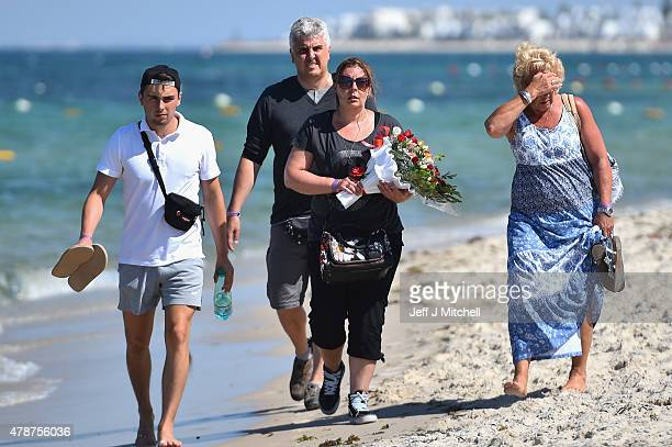 People view the scene at the beach next to the Imperial Marhaba Hotel where 38 people were killed yesterday in a terrorist attack on June 27 2015 in...