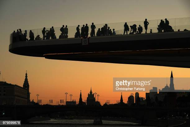People view the setting sun from an observation deck over the Mosvow River near Red Square on June 20 2018 in Moscow Russia Uruguay's 10 win over...