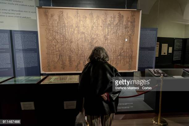 People view the sketch for the internal gate of the Fosse Ardeatine created by Mirko Basaldella in 1949 as it is displayed for the occasion of...