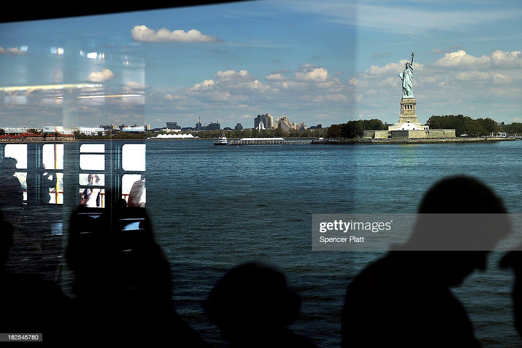 People view the Statue of Liberty, one of New York's premiere tourist attractions, from the Staten Island Ferry on September 30, 2013 in New York City. If Congress fails to pass a budget, the U.S. government would be forced to shut down at midnight on Monday. One of the results of a goverment shutdown would be the closing of all national parks including the Statue of Liberty and Ellis Island.