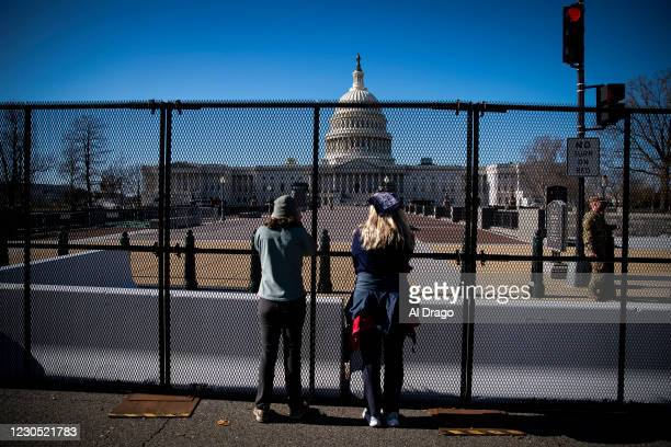 People view the U.S. Capitol, behind security fencing, on January 10, 2021 in Washington, DC. A pro-Trump mob stormed and desecrated the U.S. Capitol...