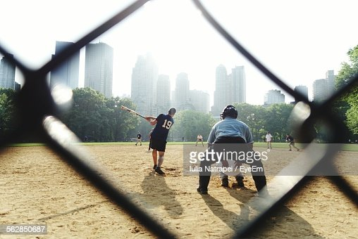 People Viewed Through Fence Playing Baseball Game