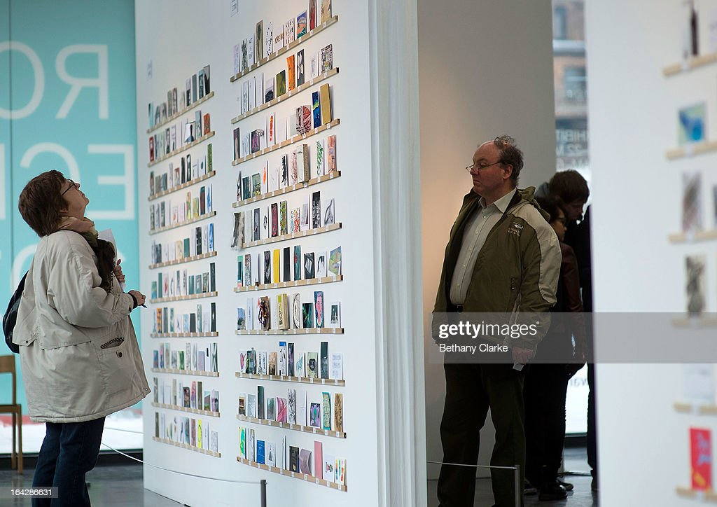 People views an exhibition of 2,700 post-card size artworks at the Royal College of Art on March 22, 2013 in London, England. The Artworks, including work by Julian Opie, Paula Rego, David Bailey, Sir Paul Smith and Nick Park will go on sale on Saturday 23 March from 7am, costing just £45 each. The creators of the postcards remain anonymous until they are bought and the signature is revealed on the back. The RCA are hoping to raise over £120,000 from this year's sale.