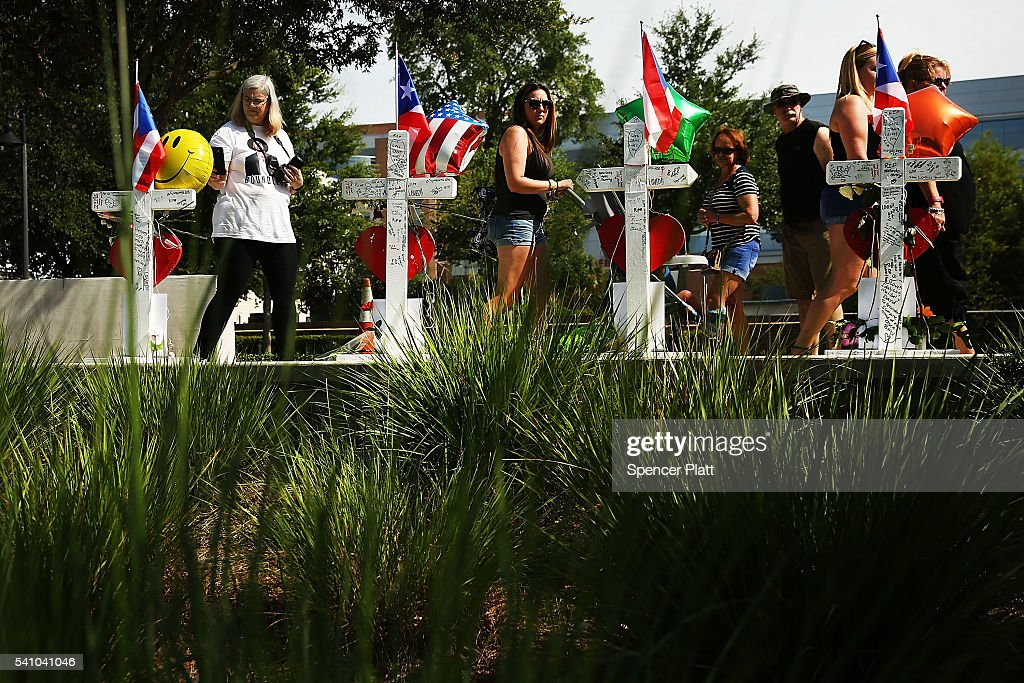 People visit a a memorial down the road from the Pulse nightclub on June 18, 2016 in Orlando, Florida. In what is being called the worst mass shooting in American history, Omar Mir Seddique Mateen killed 49 people at the popular gay nightclub early last Sunday. Fifty-three people were wounded in the attack which authorities and community leaders are still trying to come to terms with.