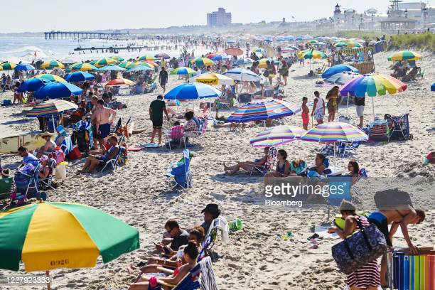 People visit a beach in Ocean City, New Jersey, U.S., on Saturday, Aug. 1, 2020. From California's wine country to Colorado's ski towns and Floridas...