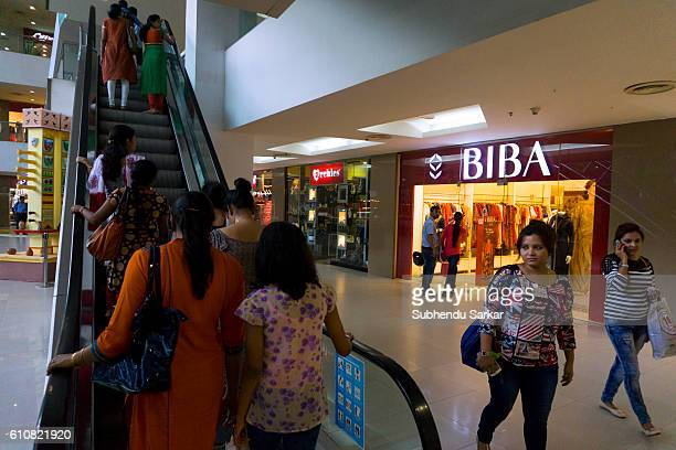 People visit a big shopping mall to buy products made by national and international brands