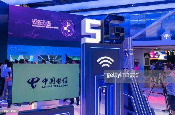 People visit a China Telecom stand displaying 5G technology during the Mobile World Conference in Shanghai on June 27 2018 / China OUT