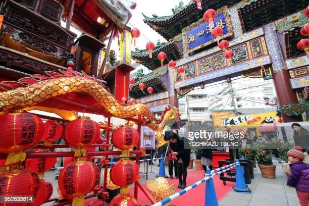 People visit a Chinese shrine at Yokohama Chinatown as Chinese Lunar New Year started in Yokohama suburban Tokyo on January 29 2017 People celebrate...