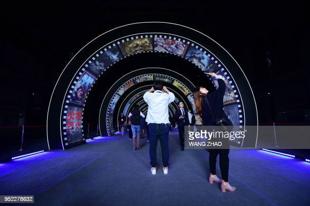 People visit a film studio at Wanda Film industrial park in Qingdao China's Shandong province on April 28 2018 A massive 'movie metropolis' billed as...