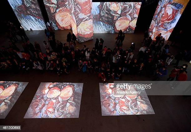 People visit a grandiose multimedia exhibition entitled Van Gogh Alive at Artplay Central Hall on January 6 2014 in the capital of Russia Moscow 3000...