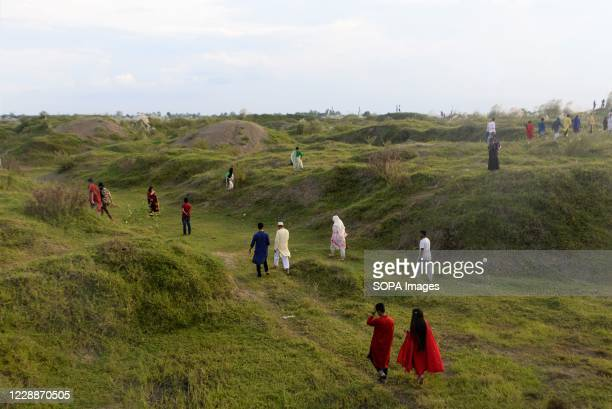 People visit a Kans grass field in Sarighat, on the outskirts of Dhaka. Kans grass field in Sarighat is one of the popular attractive destination for...