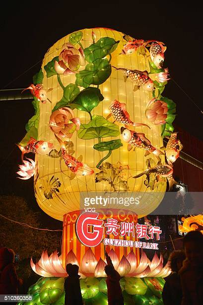 People visit a lantern show as part of celebrations of the Chinese New Year the Year of Monkey on February 14 2016 in Guiyang China Chinese New Year...