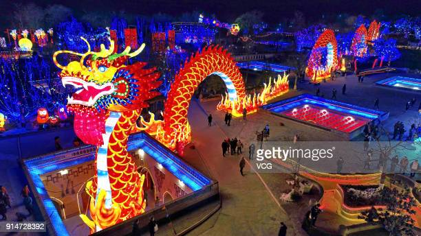 People visit a lantern show at underground cave dwellings on February 5 2018 in Sanmenxia China Chinese People are preparing for the upcoming Chinese...