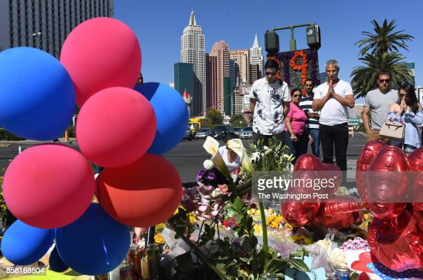 People visit a makeshift memorial along the Las Vegas Strip on Thursday October 05 2017 in Las Vegas NV Suspected gunman Stephen Paddock killed 59...