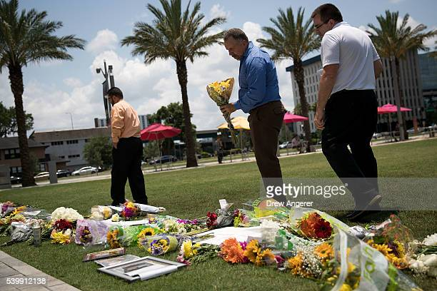People visit a makeshift memorial at Dr Phillips Center for the Performing Arts on June 13 2016 in Orlando Florida The shooting at Pulse Nightclub...