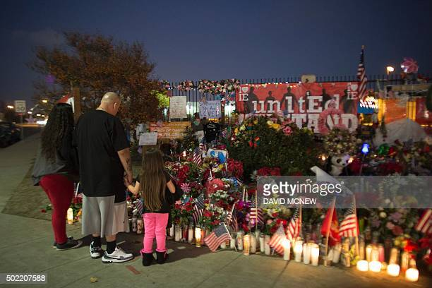 People visit a makeshift memorial near the Inland Regional Center in San Bernardino California December 21 2015 Enrique Marquez who is alleged to...