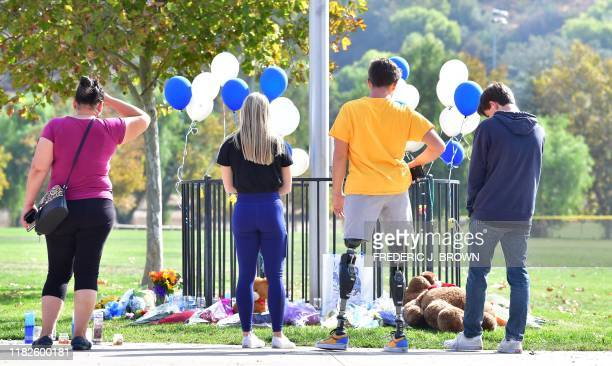 People visit a makeshift memorial on November 15 2019 at Central Park not far from Saugus High School in Santa Clarita California A teenage boy...