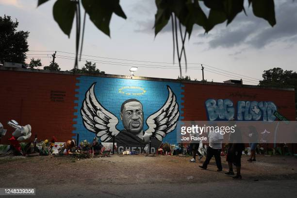 People visit a memorial and mural that honors George Floyd at the Scott Food Mart corner store in Houston's Third Ward where Mr Floyd grew up on June...