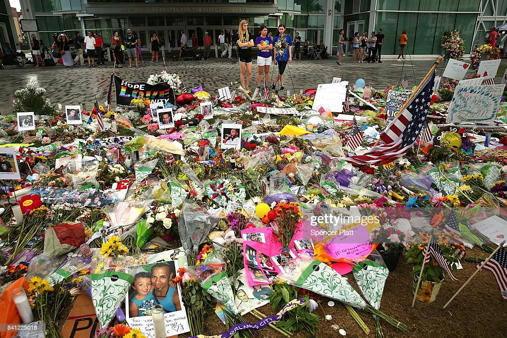 People visit a memorial down the road from the Pulse nightclub on June 19, 2016 in Orlando, Florida. In what is being called the worst mass shooting in American history, Omar Mir Seddique Mateen killed 49 people at the popular gay nightclub early last Sunday. Fifty-three people were wounded in the attack which authorities and community leaders are still trying to come to terms with.