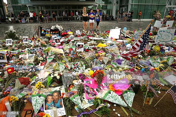 People visit a memorial down the road from the Pulse nightclub on June 19 2016 in Orlando Florida In what is being called the worst mass shooting in...