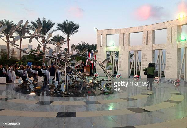 People visit a memorial in Egypt's coastal resort of Sharm elSheikh on January 3 for the victims of the Flash Airlines Flight 604 that crashed into...
