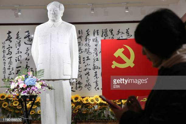 People visit a museum of artworks of the late former Chinese Communist Party leader Mao Zedong to mark his 126th birthday, in Nantong in China's...