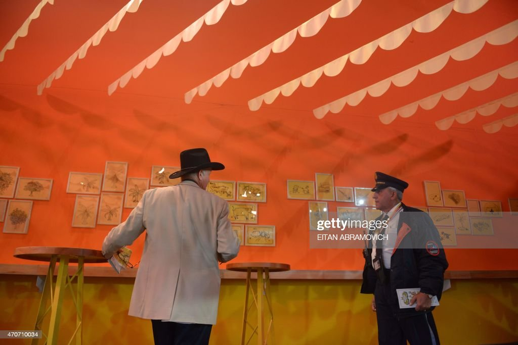 People visit a pavilion dedicated to Macondo, the fictitious town in which many of late Colombian Nobel laurate Gabriel Garcia Marquez's stories were set, during the International Book Fair of Bogota, on April 22, 2015, in Bogota, Colombia. The 2015 Bogota International Book Fair dedicates a tribute to Garcia Marquez, a year from his death. AFP PHOTO/Eitan Abramovich /