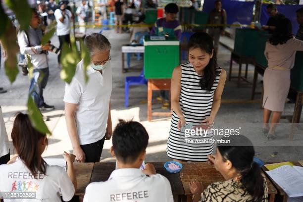 People visit a polling station to cast their ballots in the general election on March 24 2019 in Bangkok Thailand Around 50 million voters headed to...