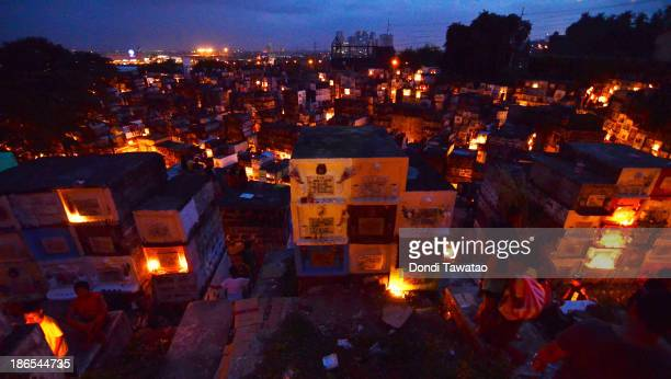 CITY PHILIPPINES People visit a public cemetery at night for All Saint's Day November 1 2013 in Marikina City Philippines As the largest Catholic...