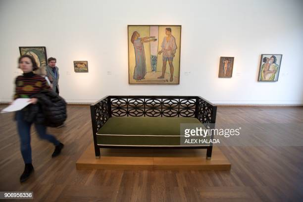 People visit a room dedicated to the work of Austrian artist Koloman Moser during the exhibition titled 'Vienna 1900' devoted to the key figures of...