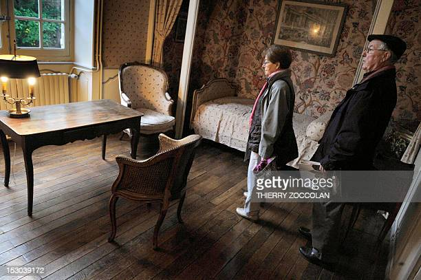 People visit a room on September 29 2012 at the Chateau de Varvasse in Chanonat central France during the auction of the furniture of the property...
