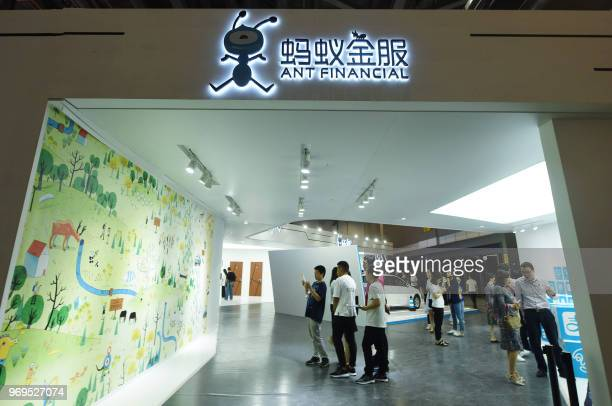People visit a showroom of Ant Financial in Hangzhou in China's eastern Zhejiang province on June 8 2018 Ant Financial a spinoff from the Alibaba...