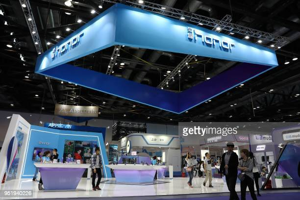 People visit a stand of Huawei Honor at the 2018 Global Mobile Internet Conference in Beijing on April 27 2018 / China OUT