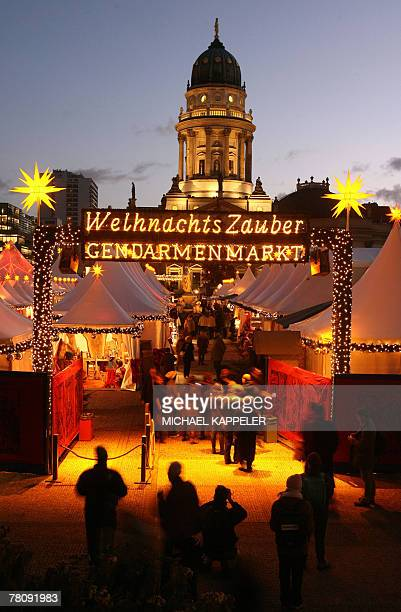 People visit a traditional Christmas Market at Berlin's Gendarmenmarkt 26 November 2007 An essential part of Christmas in Germany the seasonal...