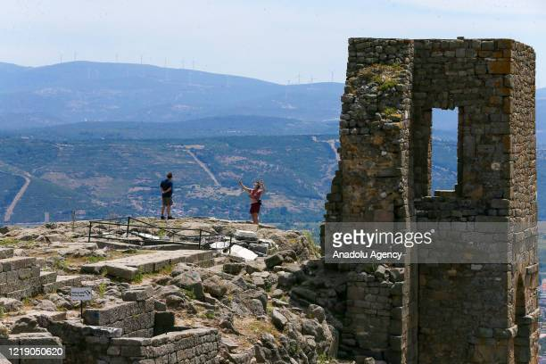 People visit acropolis of Pergamum in Bergama, which is re-opened for the visitors within the normalization phase of novel coronavirus pandemic, in...