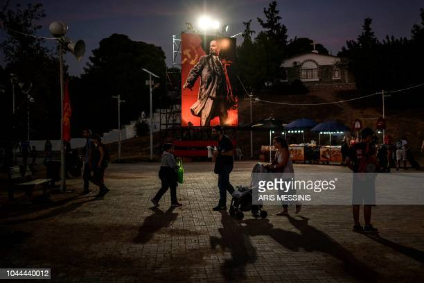 People visit an annual festival of the Greek Communist party party's youth wing in Athens on September 22 2018 The Greek Communist party KKE turns...