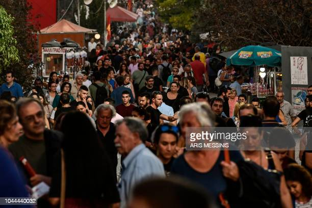 People visit an annual festival of the Greek Communist party youth wing in Athens on September 22 2018 The Greek Communist party KKE turns 100 next...