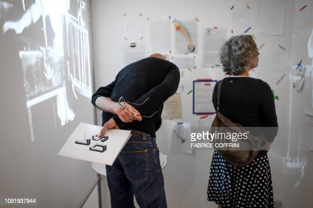 People visit an exhibition entitled 'LSD the 75 Years of a Problem Child' at the Swiss National Library on September 21 2018 in Bern Lysergic acid...