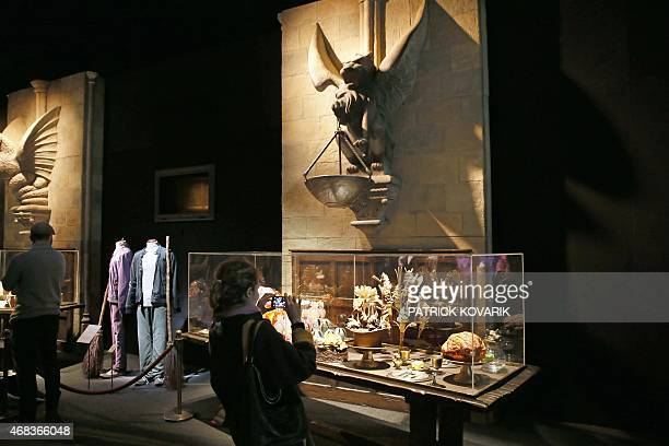 People visit an exhibition on the literary characters and themes of the Harry Potter novels at the Cite Du Cinema on April 2 in SaintDenis Harry...