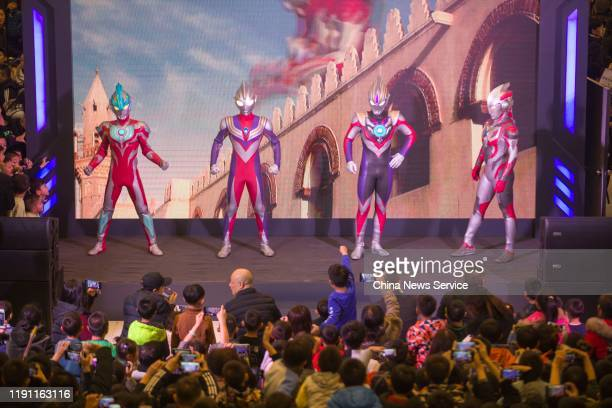 People visit an exhibition with the theme of 'Ultraman', an old movie series in Japan created in 1966, at a shopping mall on November 30, 2019 in...