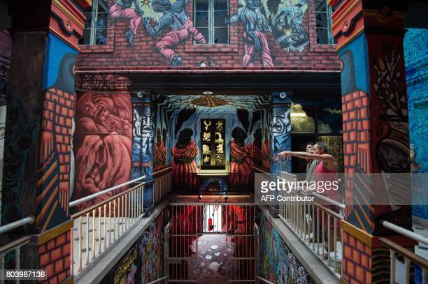 People visit an installation entitled 'Entrez libre' by Pick Up Production in the former prison of Nantes on June 29 2017 during the 6th edition of...